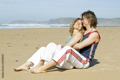 Young couple in love enjoying eachother at the beach