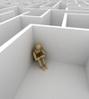 Depression - depressive mannequin sitting in corner of big maze