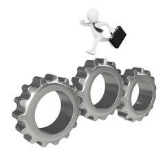 Businessman running over big gears