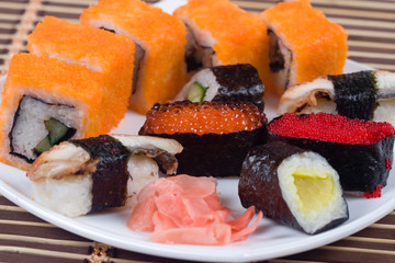 Traditional japanese sushi and rolls close up