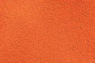 Modern grainy stucco surface in terracotta color