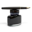 fountain pen lying on the ink bottle