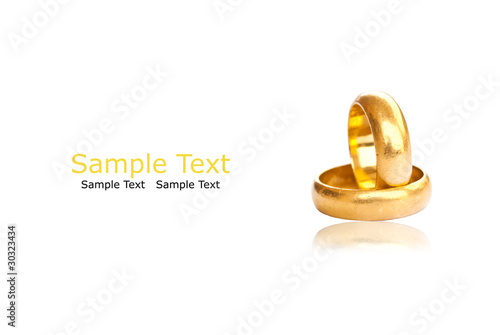 Two gold rings on the white with shadow.