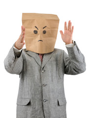 Angry businessman in ecological paper bag on head.