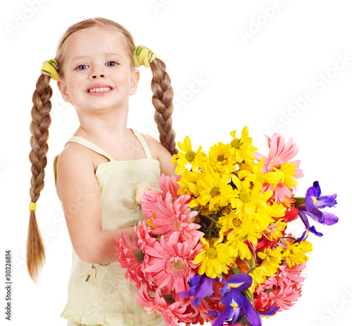 Happy child holding flowers. Isolated.