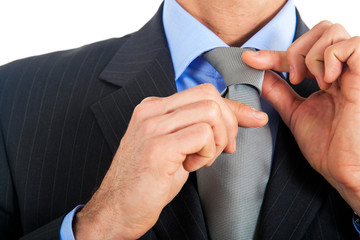 Businessman correcting his tie