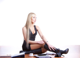 Sexy woman sitting on office desk