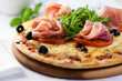 Pizza with prosciutto,tomatoes and rocket