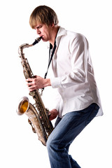Young man playing the saxophone over white background