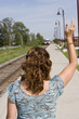 Commuter train woman waving