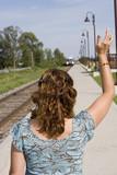 Commuter train woman waving poster