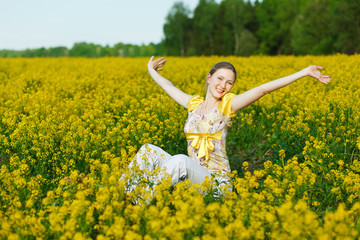 happy woman on yellow field
