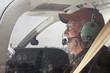 Leinwanddruck Bild - Senior Pilot in the cockpit of a Cessna twin engine