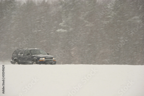 SUV driving during a blizzard