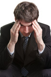 Headache of a tired and stressed businessman