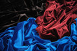 blue red and black glossy velvet is formative folds
