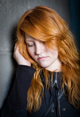 Sadness - moody portrait of a redhead girl.
