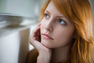 Romantic portrait of a beautiful redhead girl.