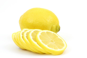 whole lemon and slices on white background