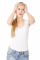Woman with headache holding her hand to the head