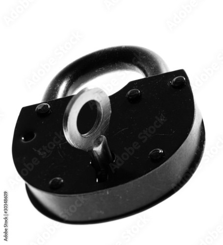 old padlock with key over white background