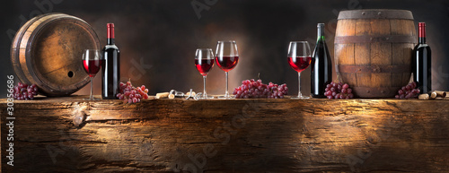 Papiers peints Vin still life with red wine with barrel on old wood