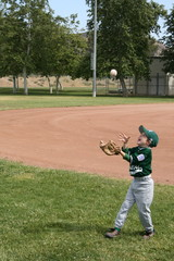 Young boy tossing baseball