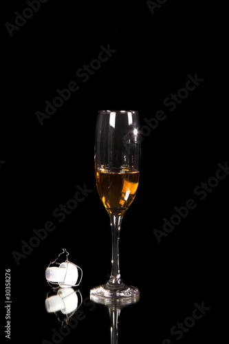 champagne glass with plastic corn