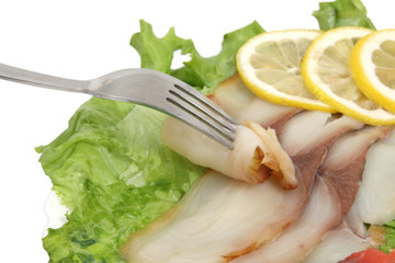Fork , fish slices and lemon