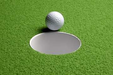 Golf ball at hole