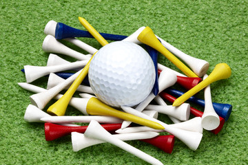 Golf ball and colorful tees