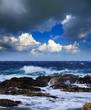 Sea  wave breaking against  rock