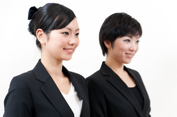 two asian businesswomen standing