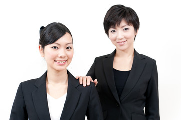 a portrait of two asian businesswomen