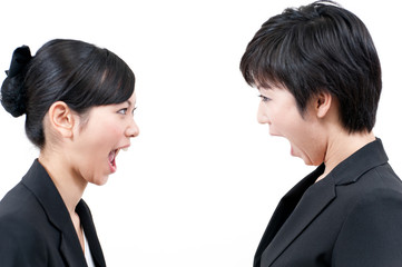 two asian businesswomen bellowing