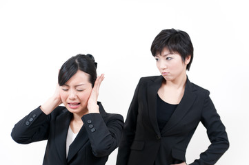 two asian businesswomen in trouble