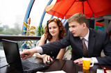 Business man and woman discuss commercial transaction poster
