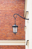 The Wall of Wawel Castle. Wall with street lamp. poster