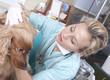 Young female vet examining the dog
