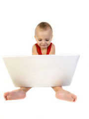 happy baby boy using a laptop computer