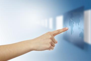 finger pressing virtual world map