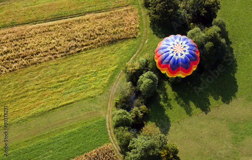 Fotobehang Ballon Over the fields in hot air balloon.