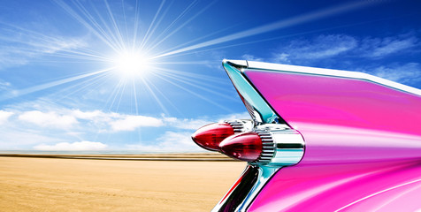Pink cadillac on beach