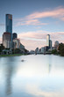 Melbourne skyline across the Yara River with single sculler