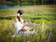 young woman reads a book on the nature