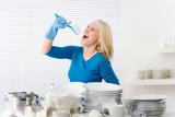 Modern kitchen - woman pretend to sing song poster