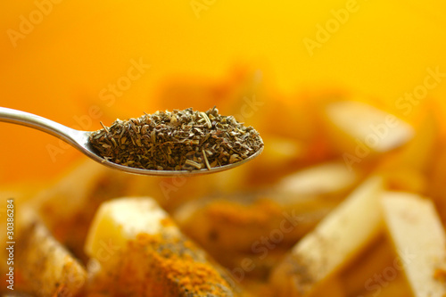 Spoon with dried spices