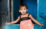 Young Asian girl living in poverty - Philippines poster