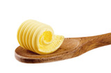 Butter curl on a wooden spoon