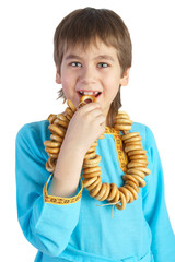 The boy eating a bread ring, isolated